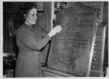 Woman Polishing a Plaque Dedicated to Minnesota Swedes and Finns